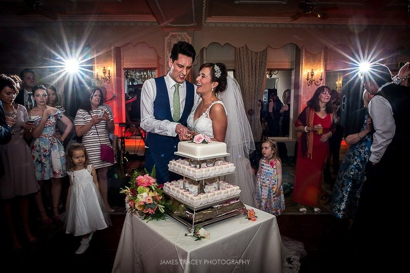 bride and groom cutting the wedding cake merewood country house wedding photography