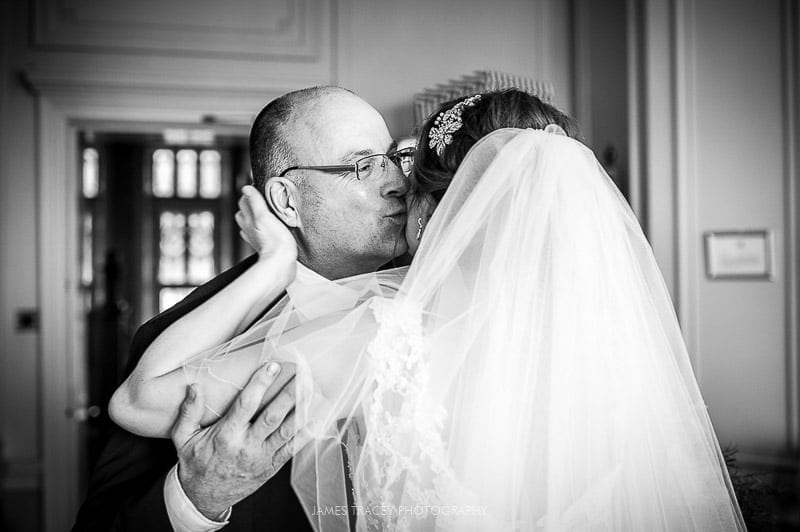 father of the bride kissing his daughter