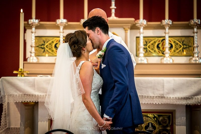 bride and groom first kiss merewood hotel wedding