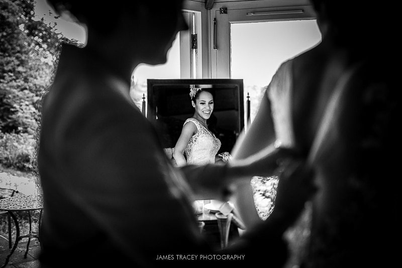 bride reflected in a mirror getting into her wedding dress at the samling hotel