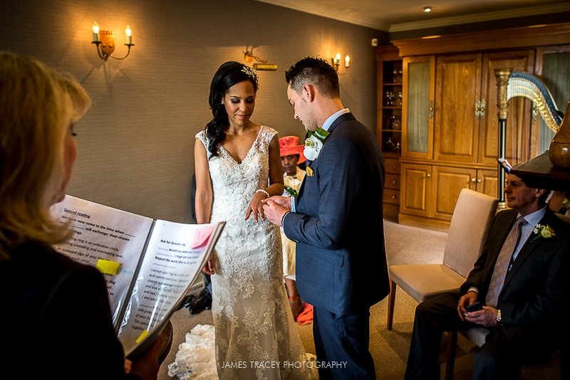 bride and groom exchanging rings at the samling wedding