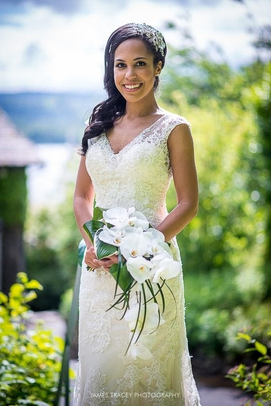 bride posing in the gardens at the samling hotel