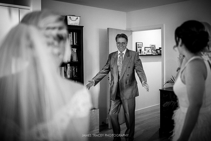 father seeing daughter in wedding dress