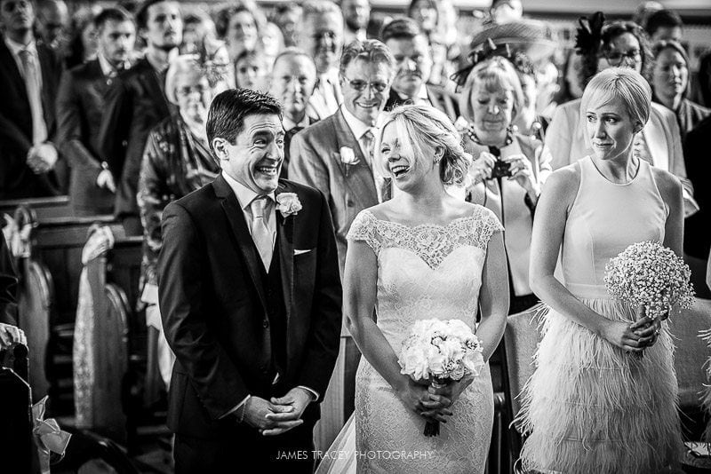 bride and groom smiling at church