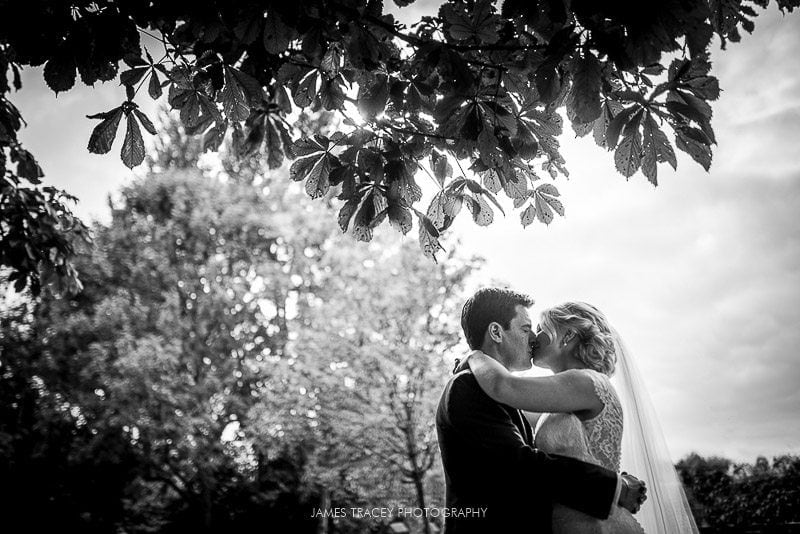 bride and groom kissing in fletcher moss park