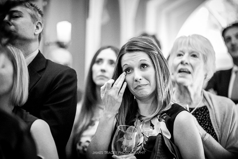 wedding guest wiping a tear away