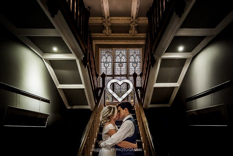 bride and groom kissing at didsbury house hotel