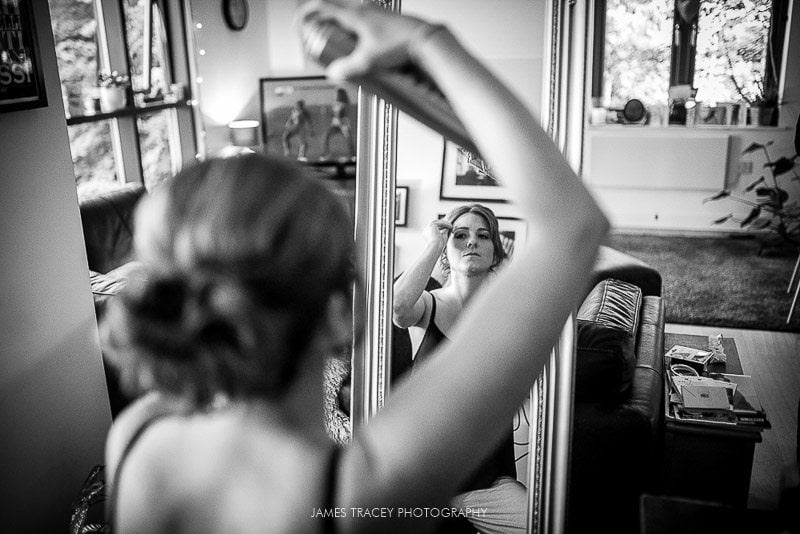 bridesmaids doing her hair