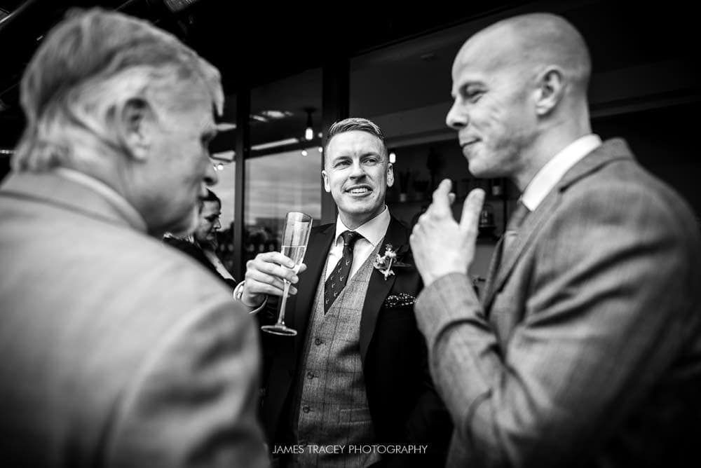 groom chatting at king street townhouse