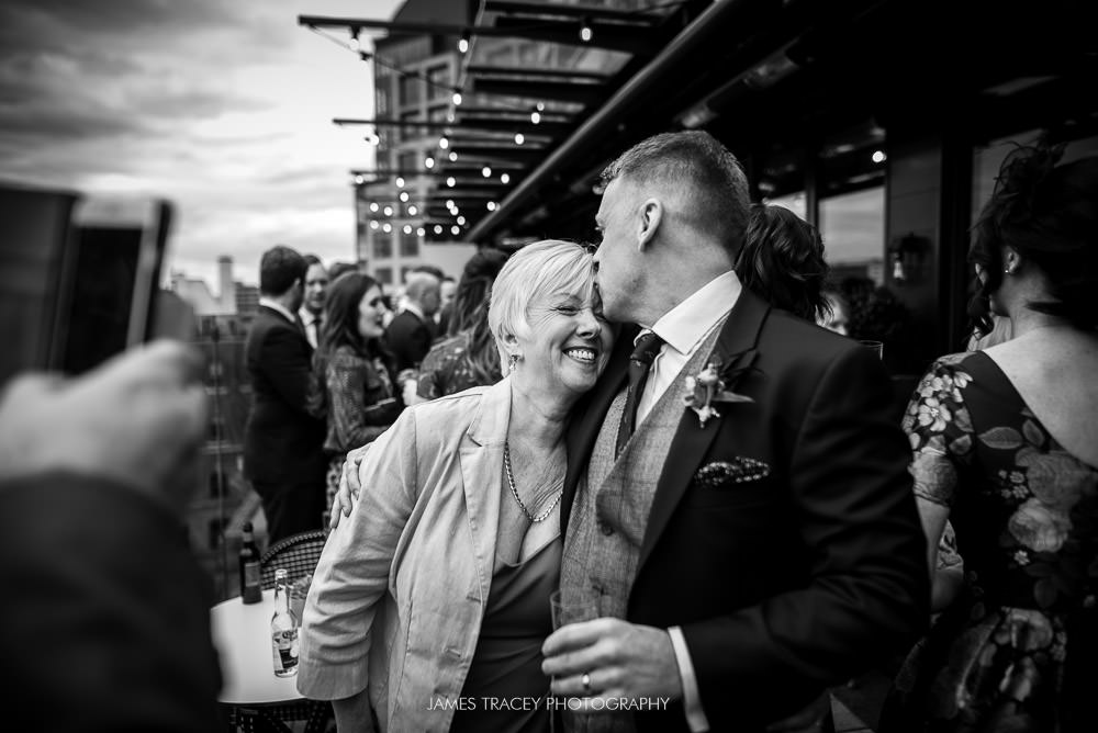 groom kissing his mother at king street townhouse