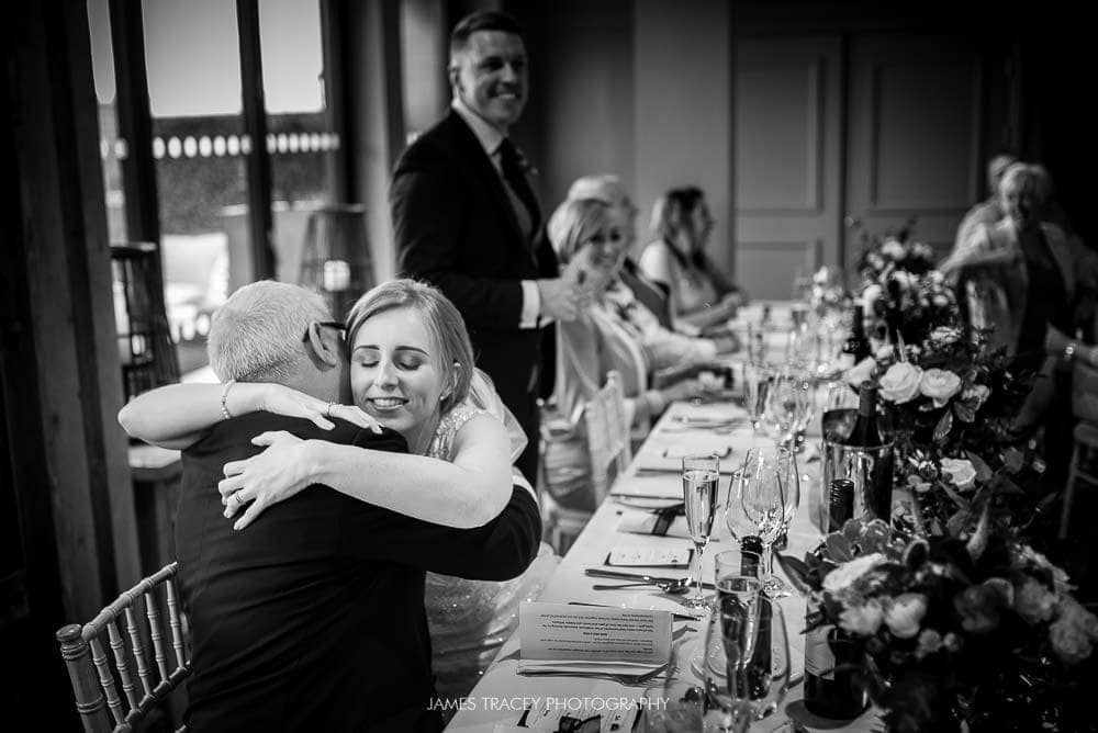 bride hugging her father at king street townhouse