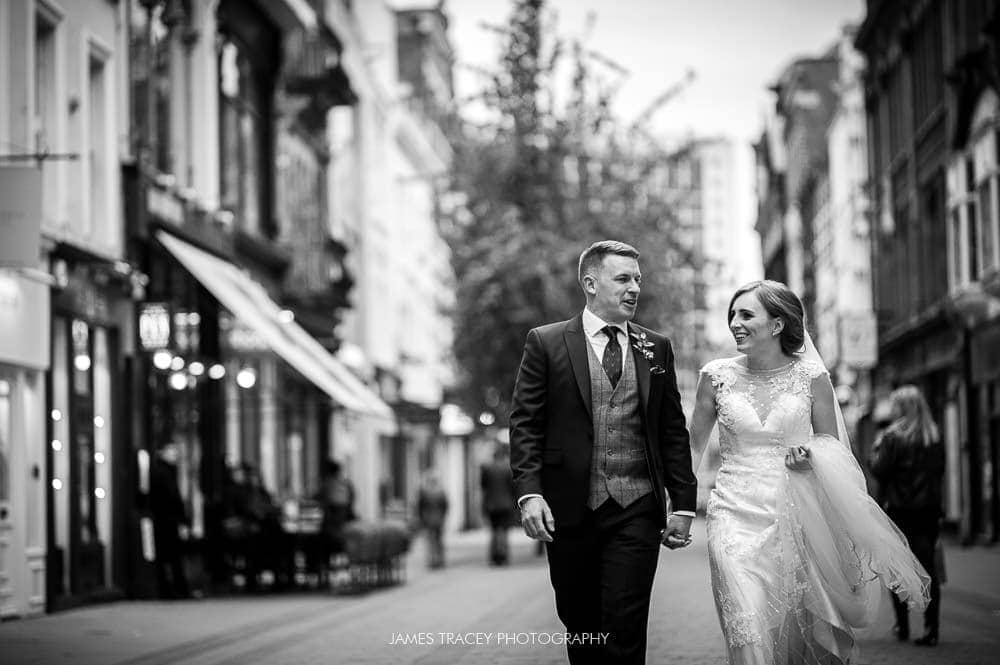 bride and groom on king street manchester