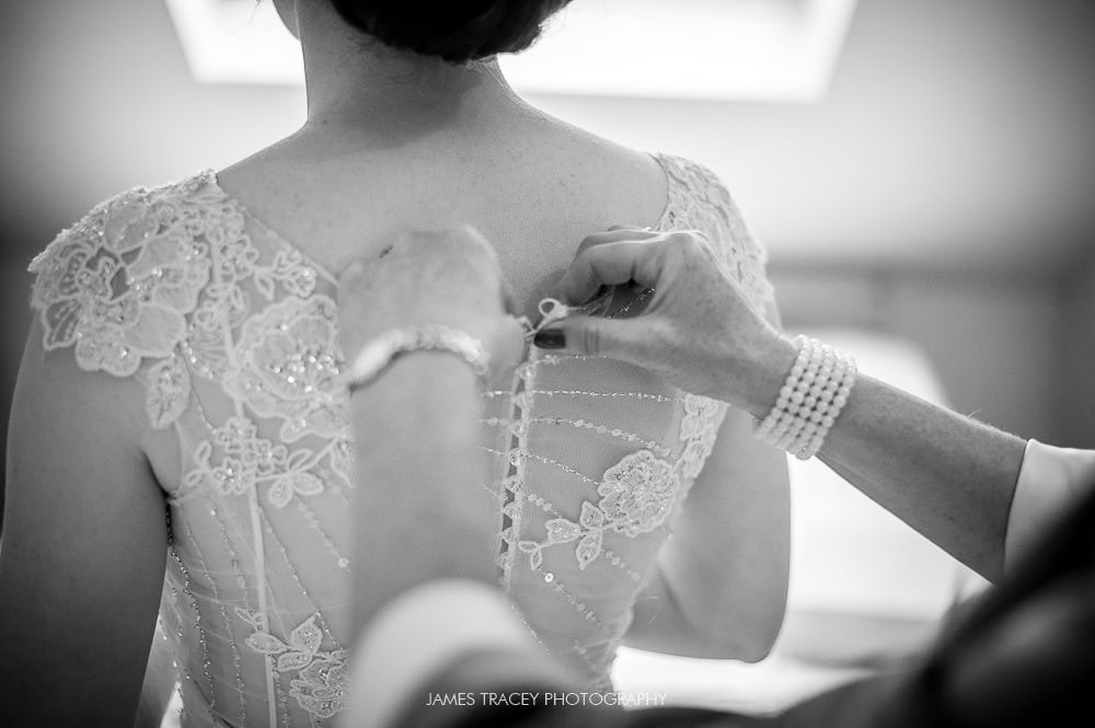 bride getting in her wedding dress