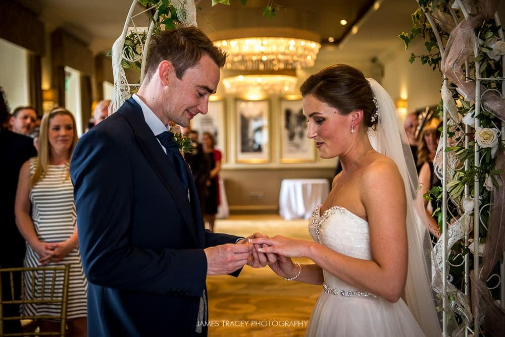 exchange of wedding rings at wedding at the mansion leeds