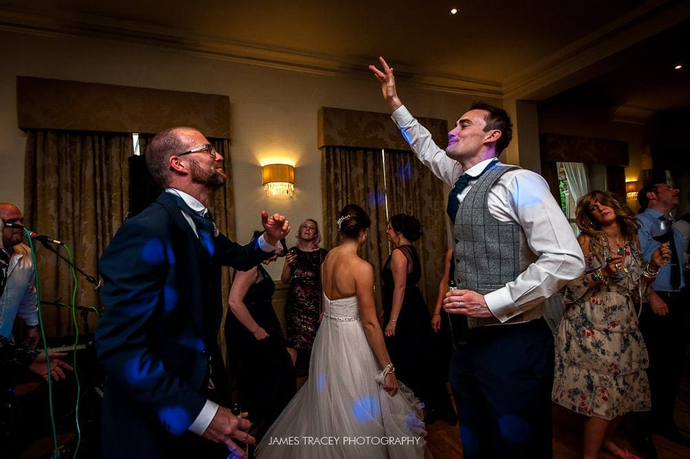 groom and usher dancing