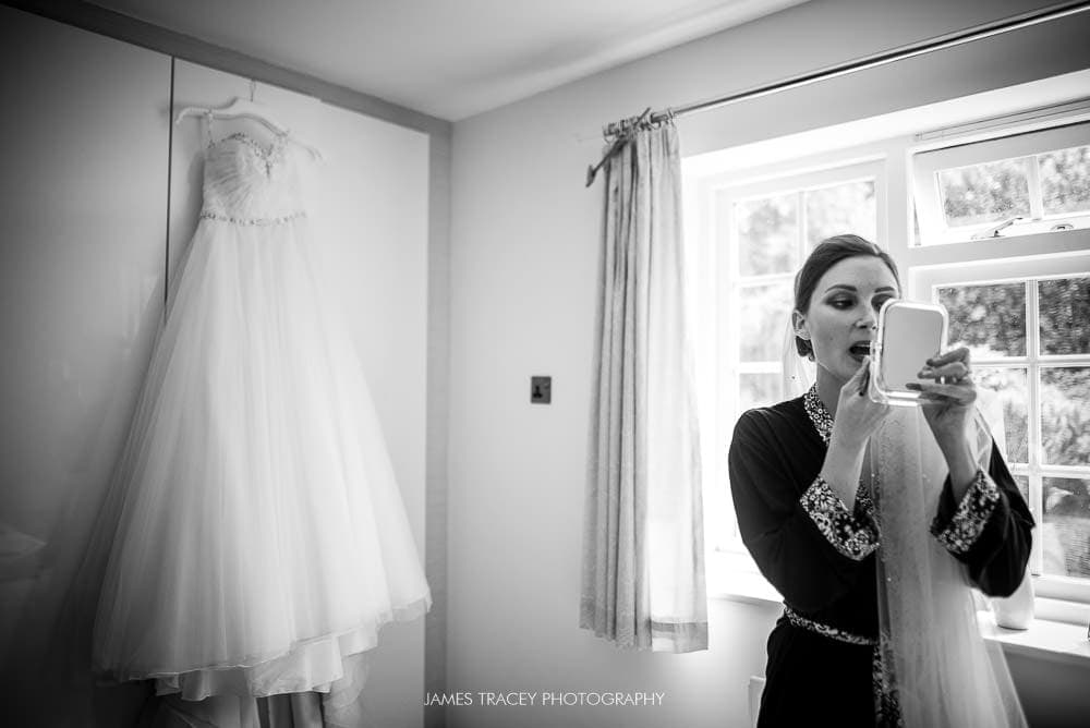 bride getting ready with dress in background