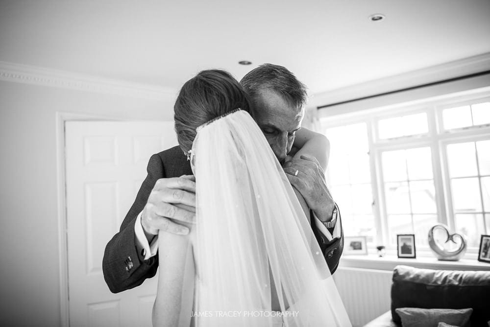 brides dad hugging her