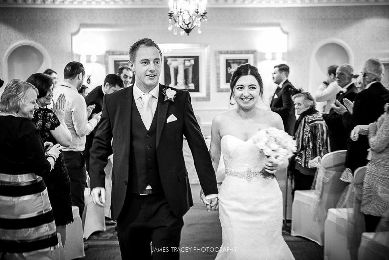 wedding couple walking back down the aisle
