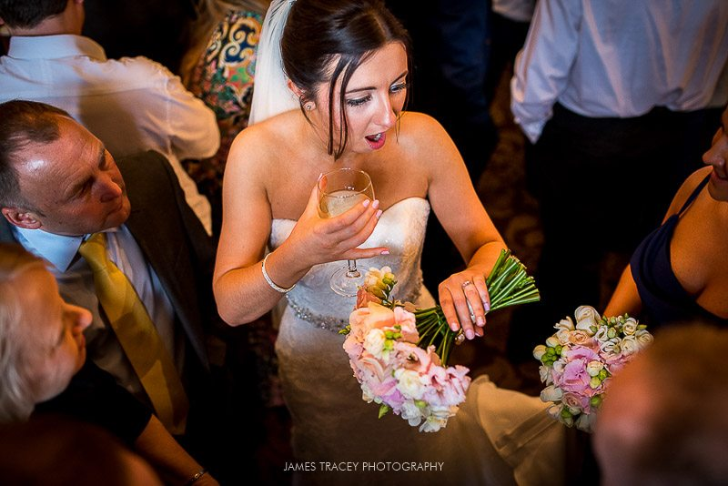 bride showing off her wedding ring
