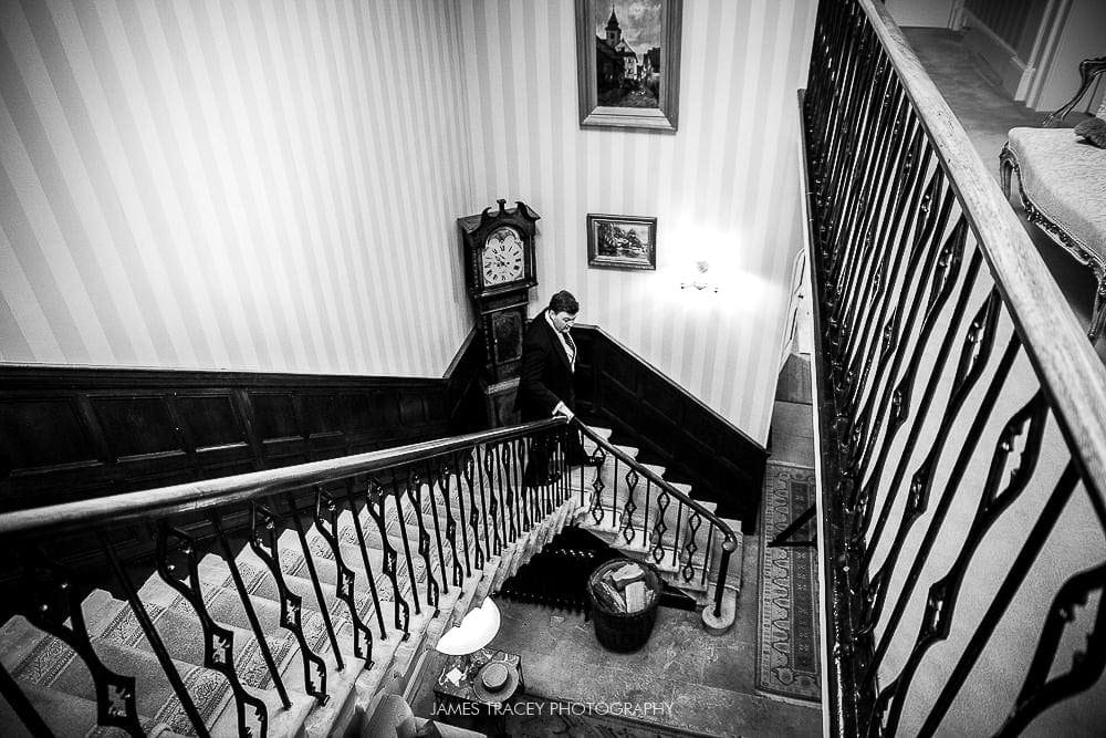 groom walking down stairs