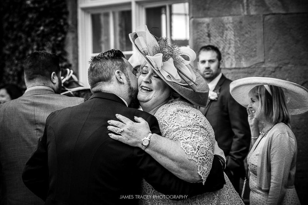 grooms mum hugging guest