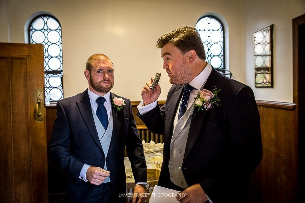 groom having drink from hip flask