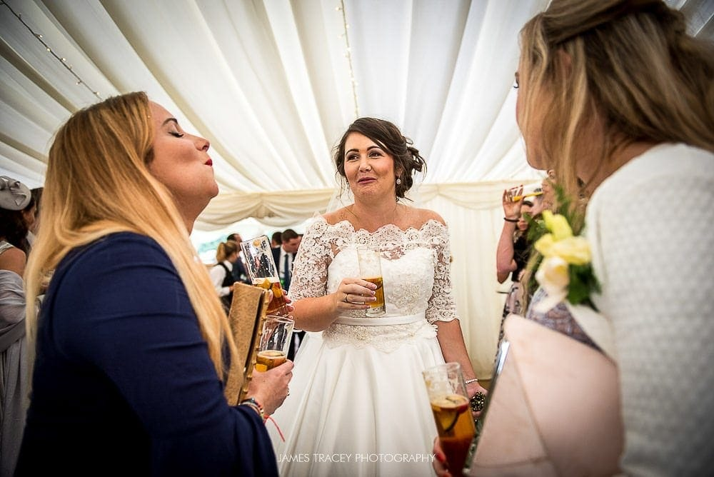 bride sharing a joke with friends
