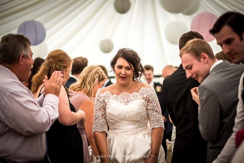 bride walking into reception