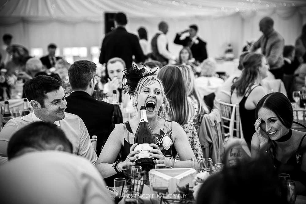 wedding guest with champagne bottle