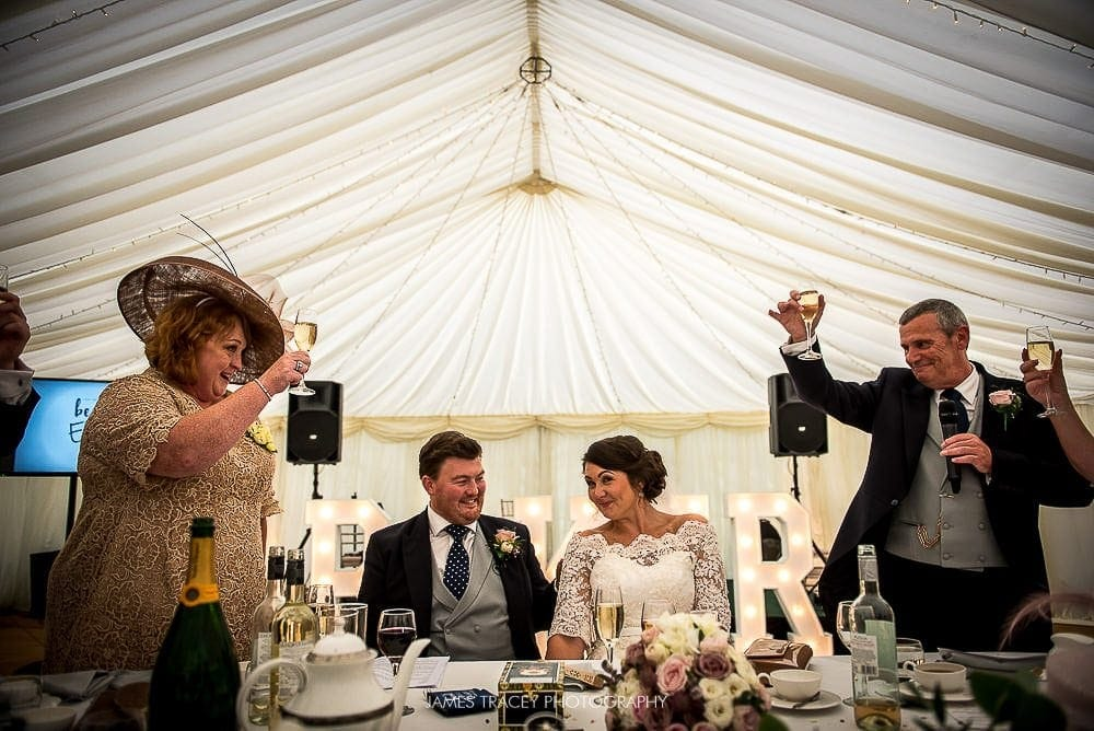 father of the bride toasting couple