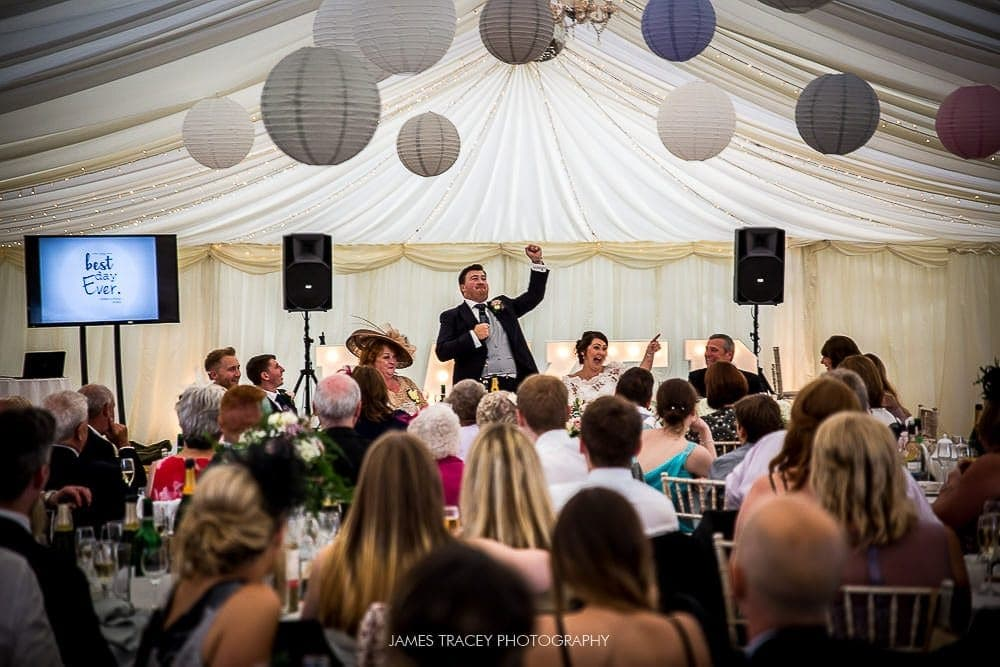 groom speaking the guests