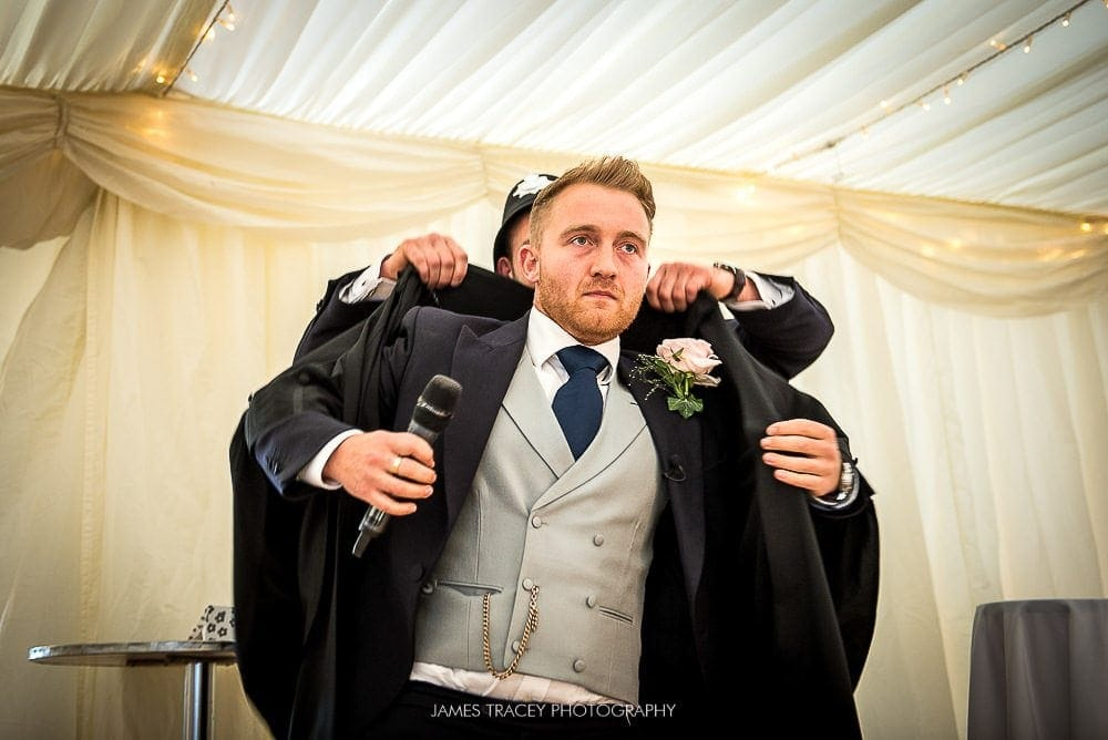 best man getting into court robes