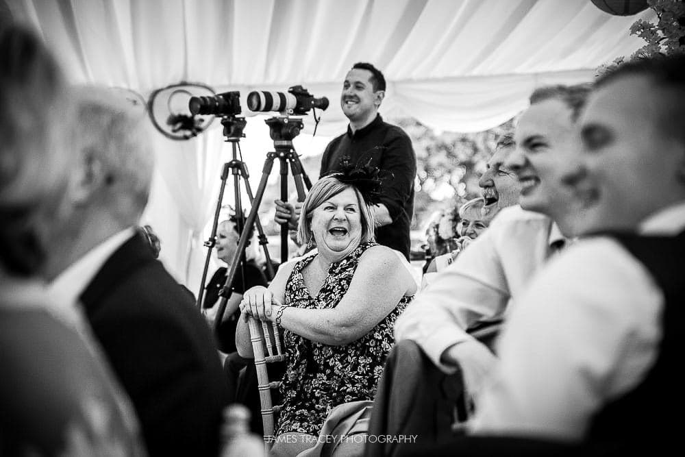 wedding guests enjoying speeches