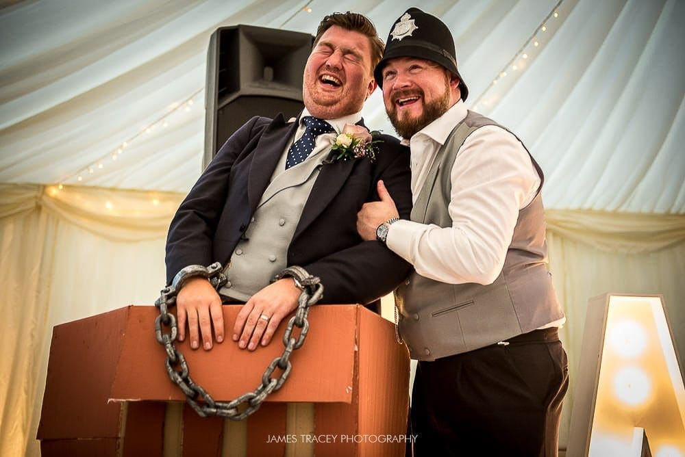 groom and gav from the rush hugging