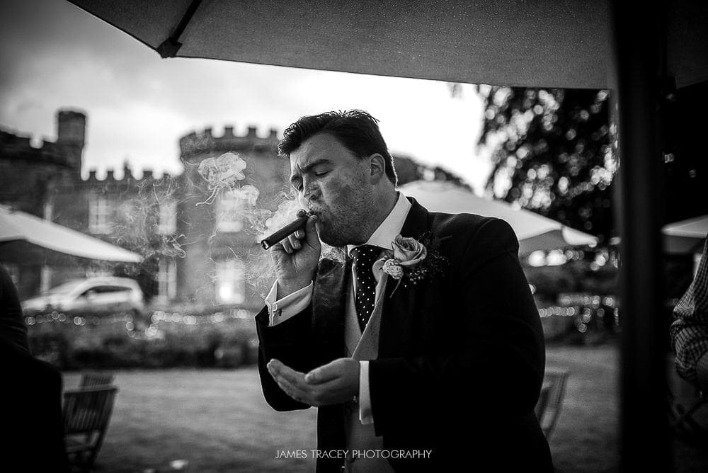 groom smoking a cigar
