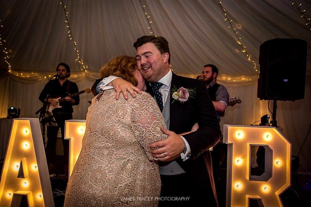 groom hugging his mum on dancefloor