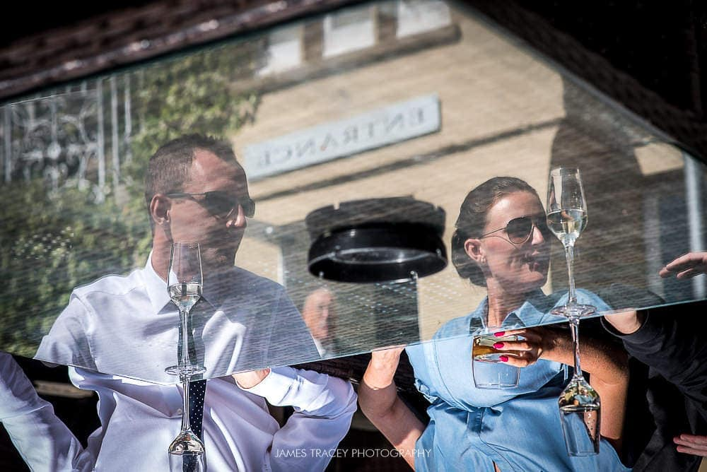 reflected wedding guests