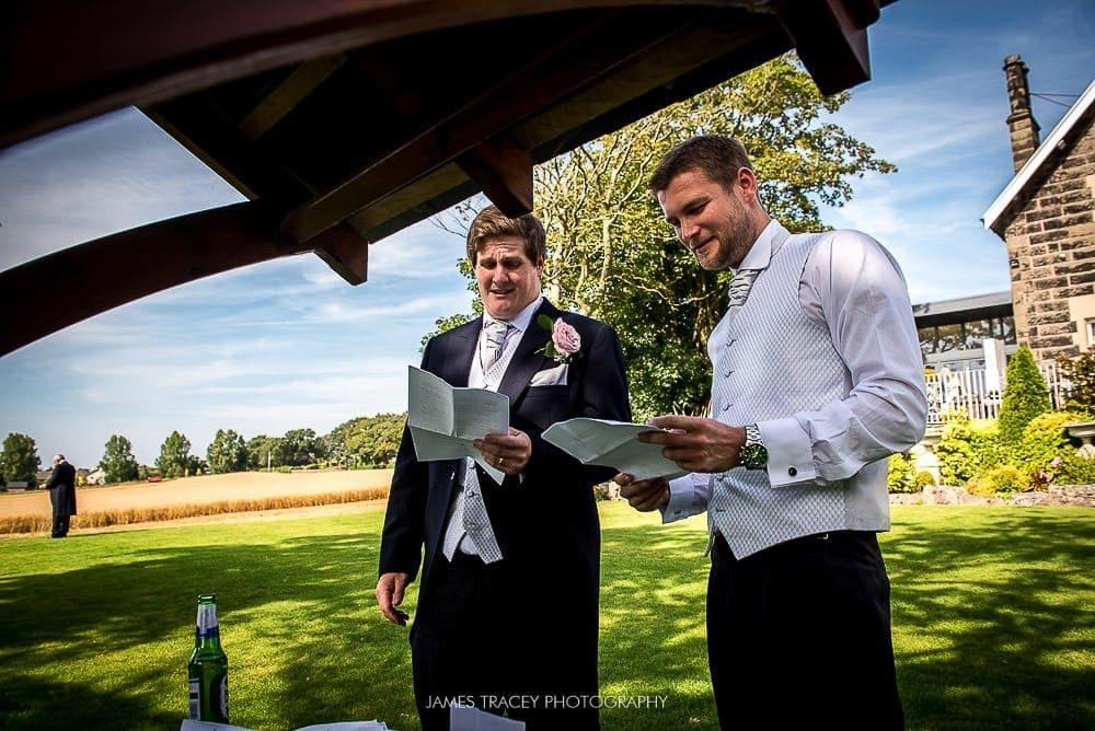 best men preparing for their speech