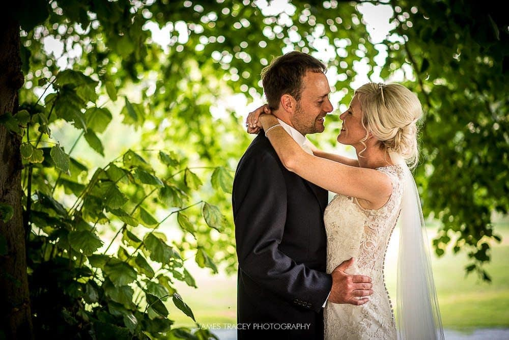 bride and groom in trees