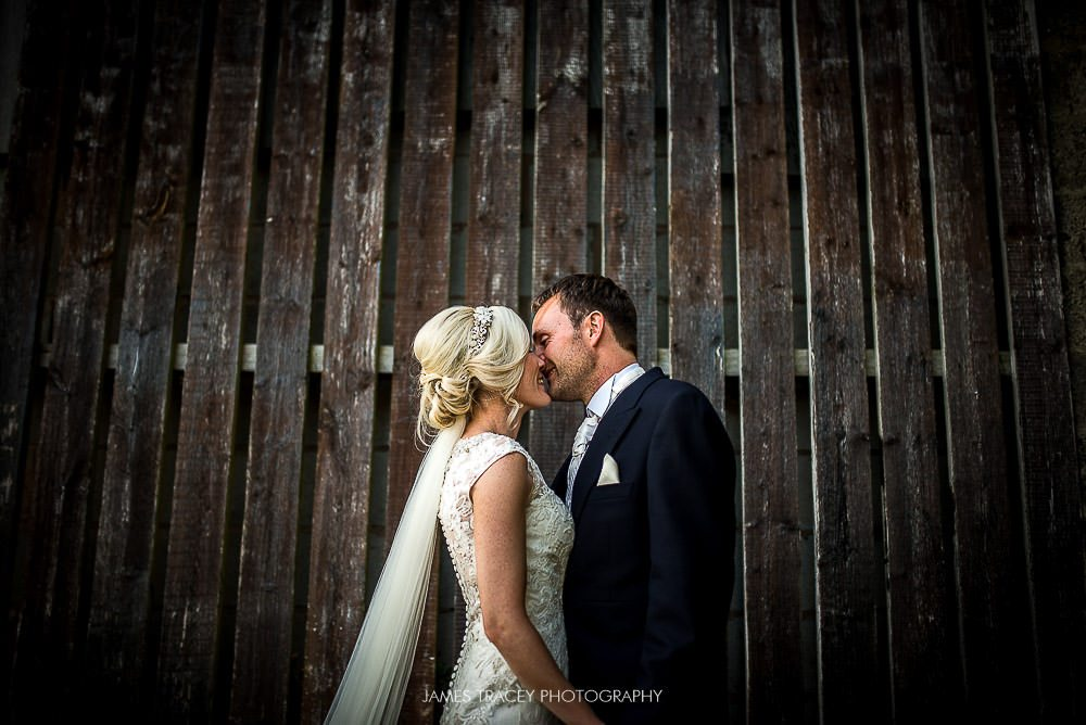 bride and groom and wooden door