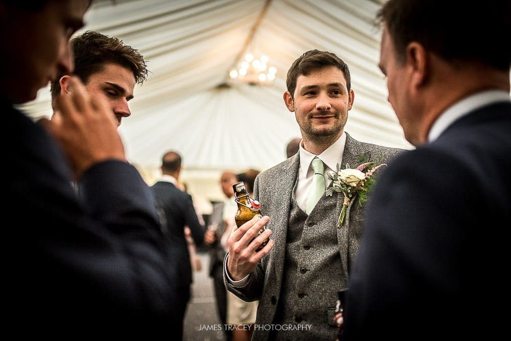 groom chatting to friends