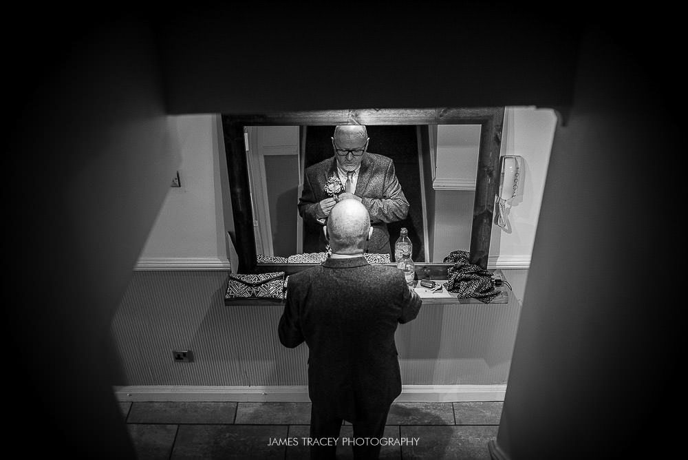 father of the bride in a mirror