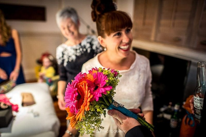 bride showing off her bouquet