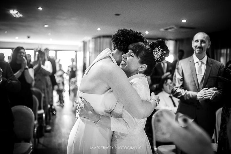 wedding hugs at service