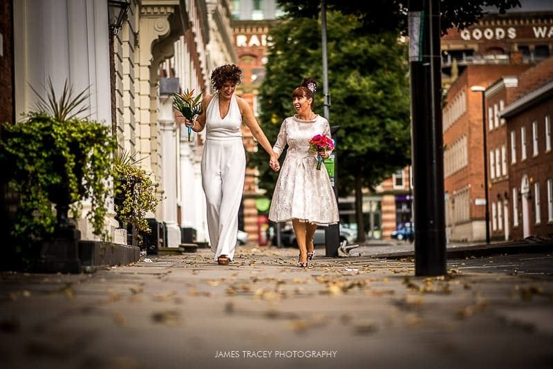 two brides walking in streest of manchester