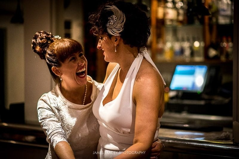 same sex brides laughing