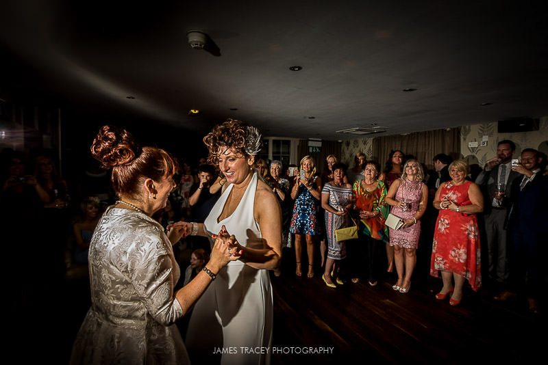 two brides dancing
