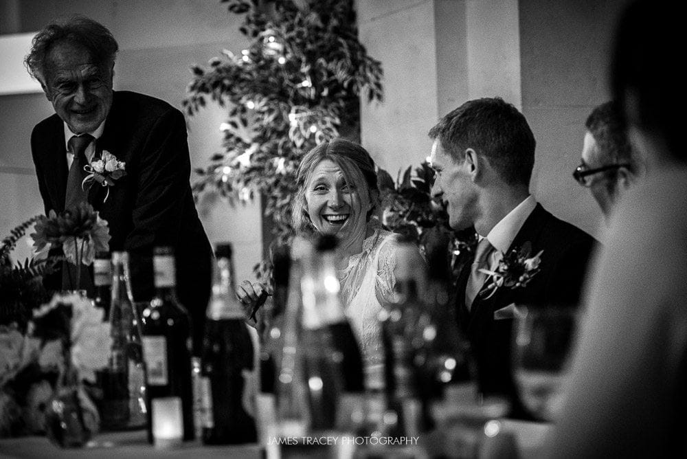 wedding couple laughing in their speeches