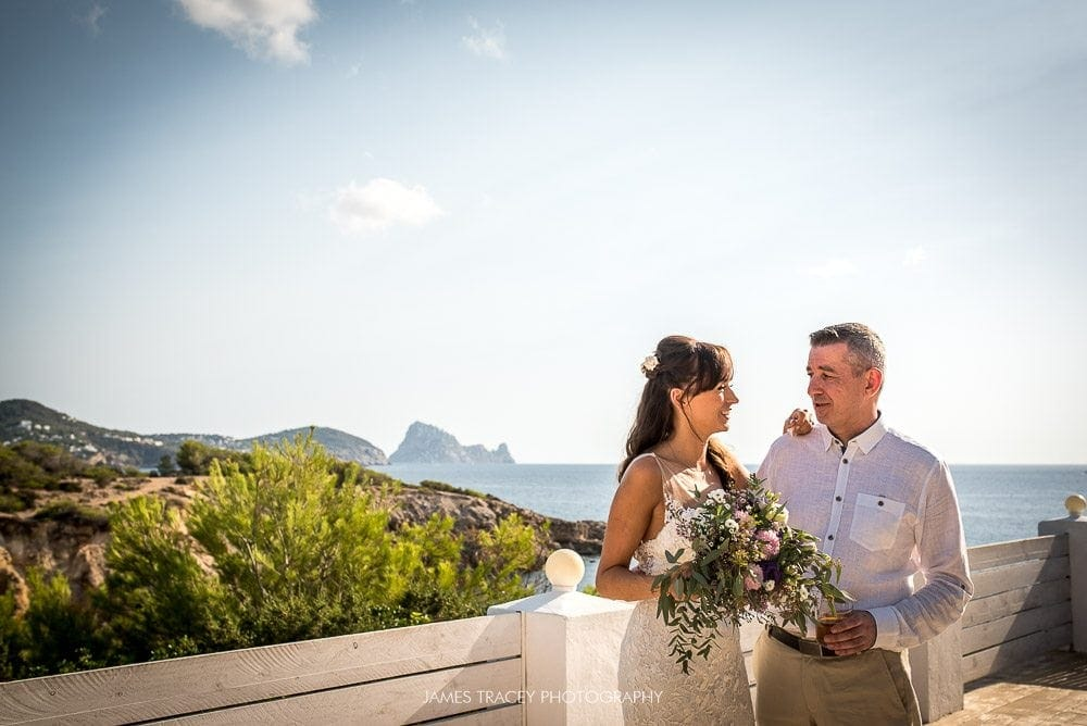 bride and groom with view of ibiza