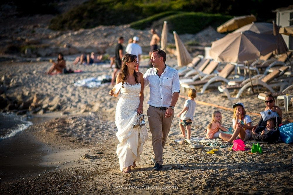 bride and groom walking on ibiza beach
